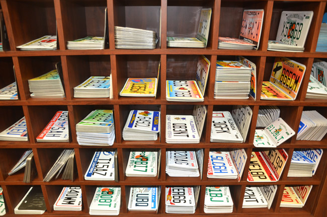 The local tax collector's office stocks almost all the state's varieties of license plates. If the motor vehicle department has its way, that'll end in January 2014, when drivers will have to get their plates by mail from Tallahassee. (© FlaglerLive)