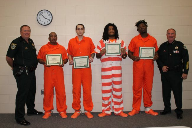 Four inmates helped detention deputies save the life of a fellow inmate on February 12 when the inmate tried to hang himself from the stairwell. Staly presented those inmates with Life Saving awards for their heroic actions.  From left: Chief Steve Cole, Gerald Smith, Joshua Keyes, Phillip Haire, Edward Sampson, and Sheriff Staly.