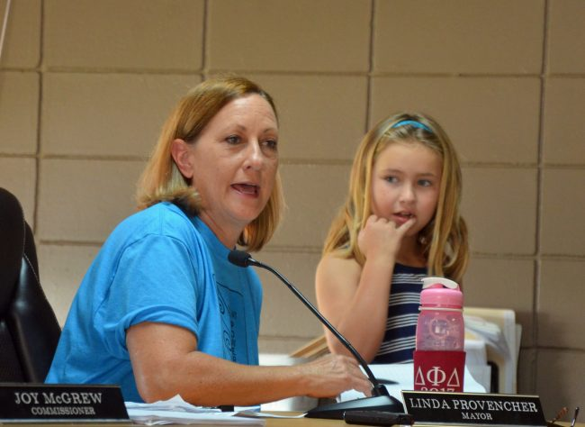 The Kids Town Hall was the idea of Linda Procencher and the All Stars, Eric Cooley and Carla Cline, whose daughter, Penelope McDonald, 7, chose to attend the meeting at the mayor's side. Click on the image for larger view. (© FlaglerLive)