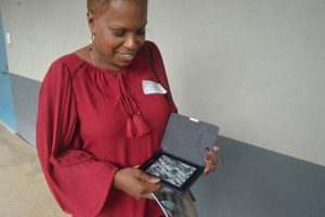 Always a reader, NAACP leader Linda Sharpe-Matthews packs a high-caliber Kindle. Click on the image for larger view. (© FlaglerLive)