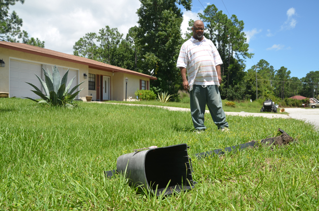 For Tyrone Williams, who was tending his yard Saturday morning, it's the third time in six years that his mailbox was knocked down. His was one of some 18 malboxes knocked down by teens on Wellshire Lane in Palm Coast early Saturday. (© FlaglerLive)