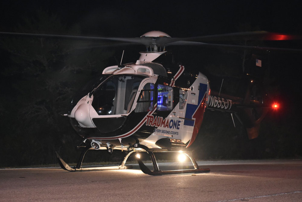 Trauma One landed at Matanzas High School after midnight Sunday to take the 20-year-old victim of a self-inflicted gunshot wound to Halifax hospital in Daytona Beach. (Palm Coast Fire Department)