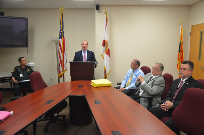 Bob Weber was to the left of Jim Manfre on the eve of the new administration's take-over, as Manfre announced impending changes and his new top team, which includes Undersheriff Rick Staly, in the light blue shirt, Human Resources Director Robert Crouse, to whom Debbie Johnson addressed her grievance, and Jack Bisland, the new head of the investigative division. (© FlaglerLive)