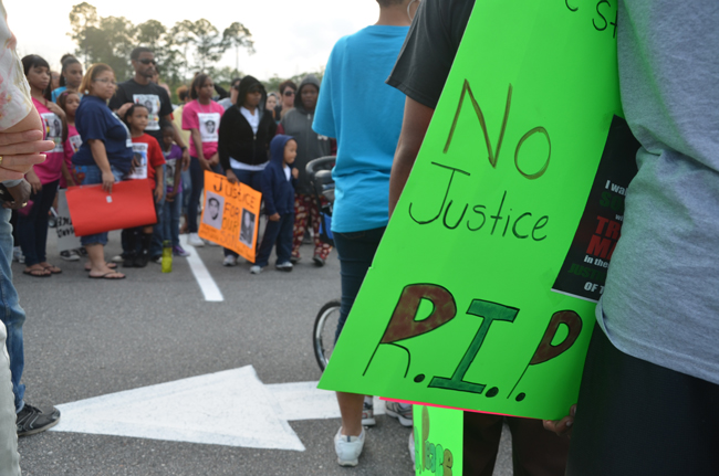 The march planned for Saturday morning in Palm Coast aims to replicate a similar solidarity march held on March 31, 2012, down Belle Terre Parkway. (© FlaglerLive)