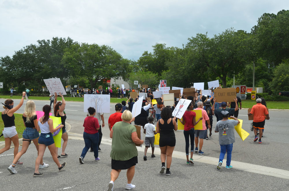 The march in Palm Coast drew upwards of 200 people. Another was held in Flagler Beach later in the day. (© FlaglerLive)