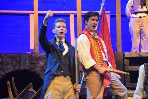 Matt Skipper, left, as Feuilly, and Chris Sepe as Enjolras. (© FlaglerLive)