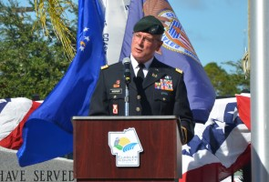 LtCdr. Mark Widener of the Florida Army National Guard delivered a keynote address that touched on conflicts and commemorations past and present. Click on the image for larger view. (© FlaglerLive)