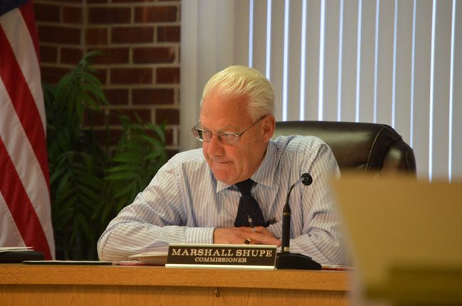 Commissioner Marshall Shupe was absent this evening, so the Flagler Beach City Commission voted 3-1 to delay its second reading of a proposed ban on medical pot dispensaries until August 10. (© FlaglerLive)
