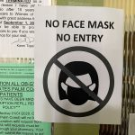 A sign in a local doctor's office may become more ubiquitous as Bunnell and Flagler Beach this evening joined Palm Coast in requiring masks in public places to fight coronavirus infections. (© FlaglerLive)