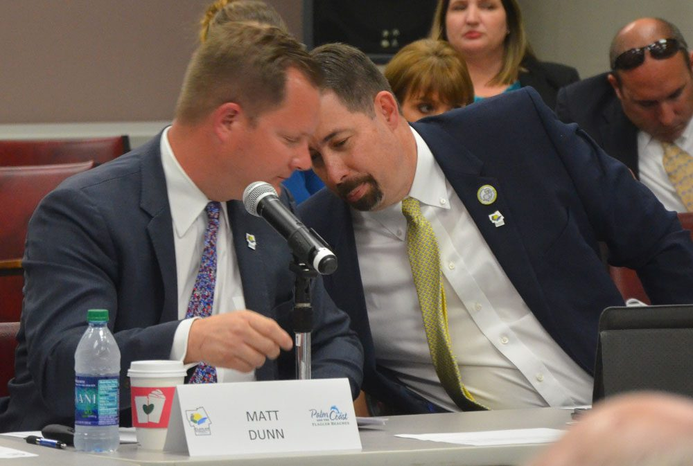 Matt Dunn, left, and former County Administrator Craig Coffey had each others' ears. (© FlaglerLive)