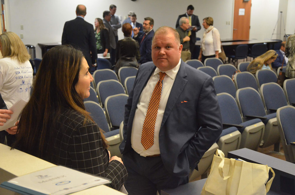 Palm Coast City Manager Matt Morton in a conversation with Mayor Milissa Holland last November. (© FlaglerLive)