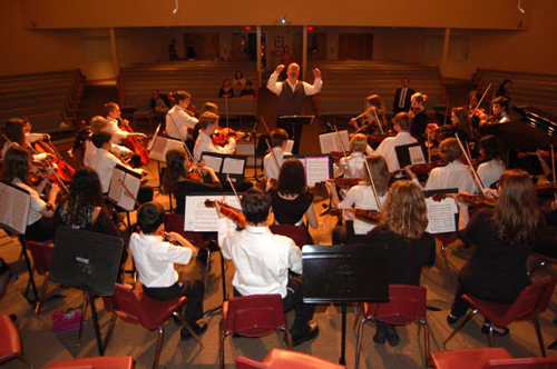 Jonathan May conducting his last performance with the Flagler Youth Orchestra, at the Palm Coast United Methodist Church, in January 2010. (© FlaglerLive)