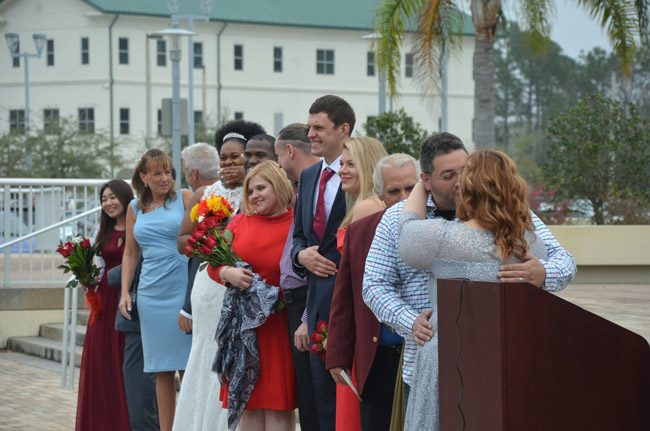 Mazel tov: some of the 16 couples the moment after they became spouses just after noon today in front of the Flagler County courthouse. (© FlaglerLive)