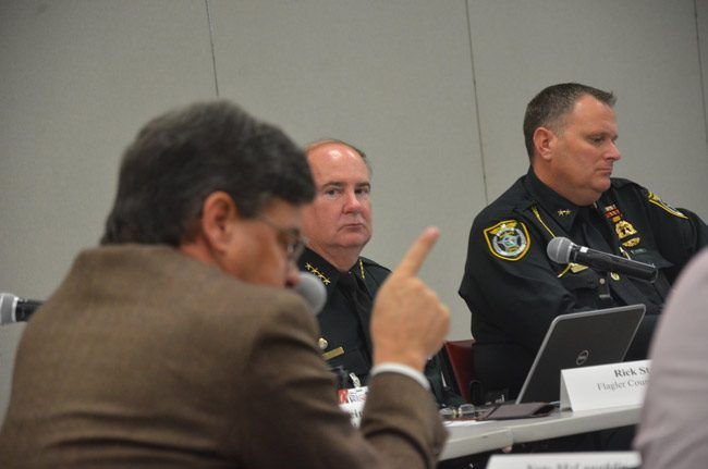 Nate McLaughlin, in the foreground, chairing the Public Safety Coordinating Council. He is also the chairman of the Flagler County Commission. He says the civil-citation program to decriminalize pot possession in small amounts will go forward to a vote at the County Commission. But Sheriff Staly, center, is not a fan of the program, and without his backing its implementation may be moot. (© FlaglerLive)
