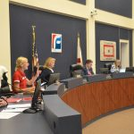 School Board Chair Janet McDonald at the beginning of Tuesday evening's meeting. It was Cathy Mittelstadt's first meeting as superintendent. Mittelstadt is in the foreground. (© FlaglerLive)