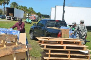 County Commissioner Nate McLaughlin stocked his truck with water and Meals Ready to Eat boxes for delivery to the west side of the county, which has been suffering particularly from power and water shortages. Click on the image for larger view. (c FlaglerLive)