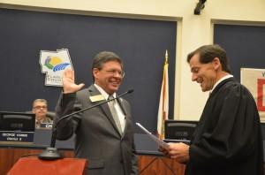 Judge Dennis Craig administers the oath for Nate McLaughlin. (© FlaglerLive)