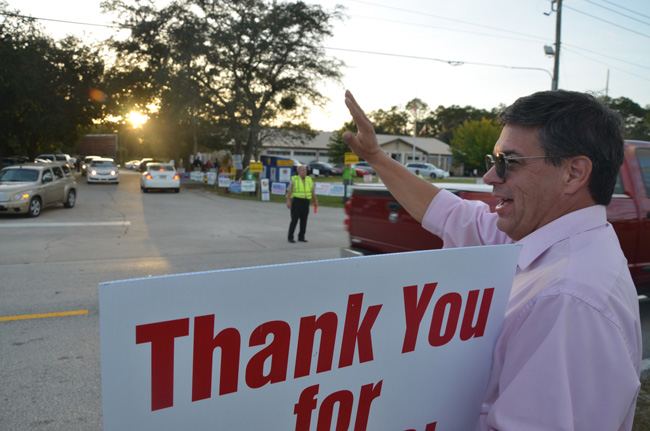 Nate McLaughlin as the sun set on the last day of Incumbent County Commissioner the 2014 campaign. (© FlaglerLive)