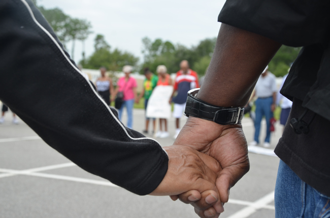 Rallies for unity and understanding in the wake of the George Zimmerman trail, like Saturday's march in Palm Coast, are focusing needed attention on a culture at times too comfortable with the the paradox of imagining itself past the sort of racially motivated mindsets that made the killing of Trayvon Martin possible. (© FlaglerLive)