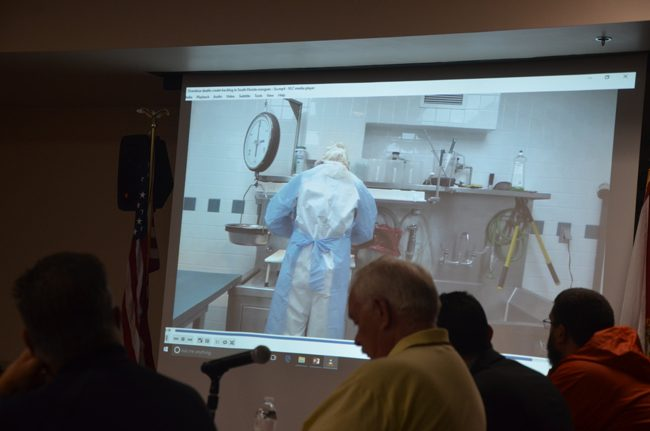 Members of Flagler County's Public Safety Coordinating Council watched a video last year during a discussion on the opioid crisis that included a brief clip showing a medical examiner performing an autopsy on an addiction victim. (c FlaglerLive)