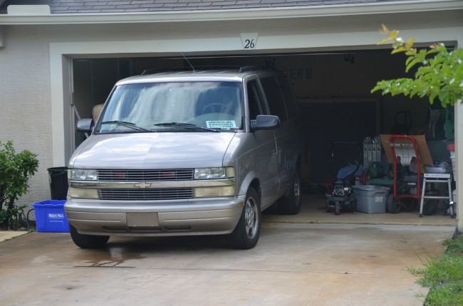 The Medical Examiner's van as it was receiving Lynn's body. Click on the image for larger view. (© FlaglerLive)