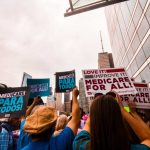 Supporters rally for universal health care in Chicago. (Shutterstock)