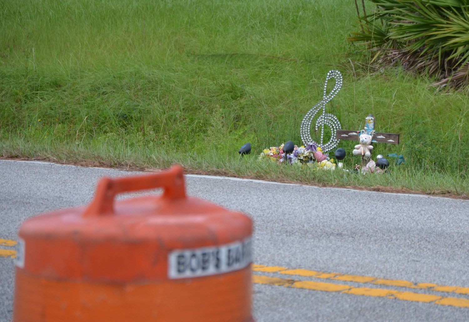 Michelle Taylor's memorial on Lakeview Boulevard in Palm Coast, opposite the construction site where a path will be built, a year and a half after she was killed by a passing car on the dark road. (© FlaglerLive)