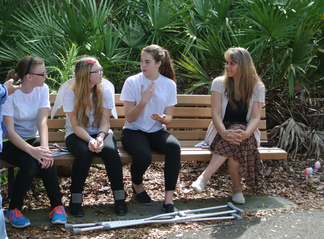 Erin Robinson, third from left, talked with her fellow Guardian Angels at Palm Coast's memorial garden Monday. She was with Indian Trails students Olivia Reynolds and Cristina Cabada, and teacher Dana Hausen. (Palm Coast)