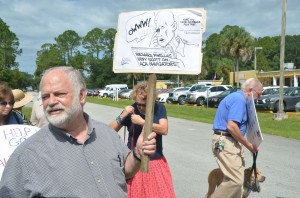 Democratic Club President Merrill Shapiro organized the demonstration. Click on the image for larger view. (© FlaglerLive)