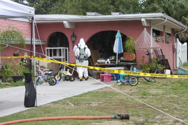 Hazmat personnel at work. Click on the image for larger view. (Sheriff's Office)