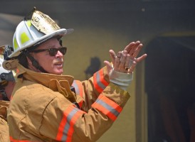 Palm Coast Fire Chief Mike Beadle in command at a fire in July 2013. Click on the image for larger view. (© FlaglerLive)