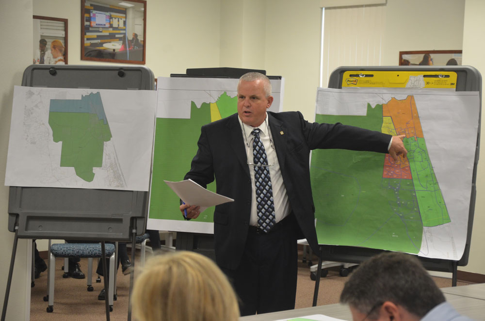 The now-retired Mike Judd, once Flagler Schools' long-time facilities director, gave the Flagler Ciounty School Board a primer on rezoning in 2017. If the Senate proposal to broadly reconfigure school choice is adopted, the Flagler district, which has been discussing rezoning for several years, would face a serious challenge on that score. (© FlaglerLive)