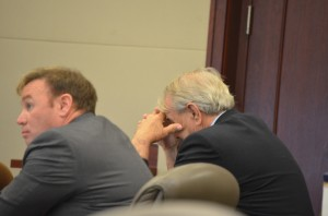 Paul Miller would not look at images of Dana Mulhall's bullet-ridden corpse when they were displayed on an easel during two witnesses' testimonies Wednesday morning. One of his two attorneys, Doug Williams, is to Miller's left. Click on the image for larger view. (c FlaglerLive)