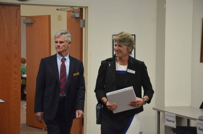 Ready to take the reins of her interview last week, Cathy Mittelstadt walked into the meeting room with the board with Bill Vogel, one of three Florida School Board Association consultants who helped the Flagler school board through the selection process. (© FlaglerLive)