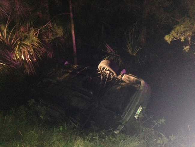 It is not yet known who was at the wheel of the Toyota when it overturned in a waterlogged ditch and killed Brianna Bellon, 23, of Palm Coast, late Sunday night. (c FlaglerLive)