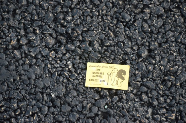 The pavement was strewn with Monopoly cards and money. Click on the image for larger view. (© FlaglerLive)