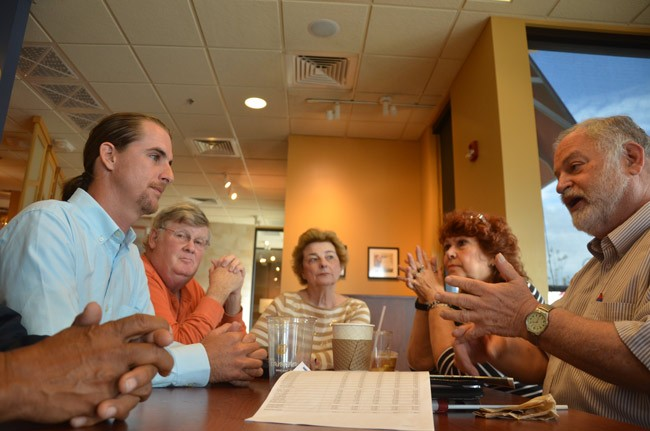 Democratic candidate Adam Morley, left, facing the Democratic Progressive Caucus's Merrill Shapiro in a get-acquainted meeting Monday at Panera Bread ion Palm Coast. Others at the table, from left, included Wayne Wright, Carol Wright and Aynne McAvoy. (© FlaglerLive)