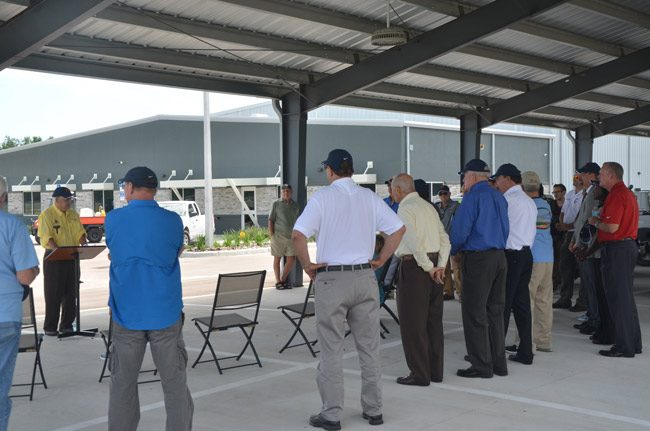 Jules Kwiatkowski, chairman of the three-member, elected Mosquito Control Board, addresses officials before the ribbon-cutting at the district's $2.1 million new headquarters last June. Kwiatkowski said he was unaware of any financial problems. (© FlaglerLive)