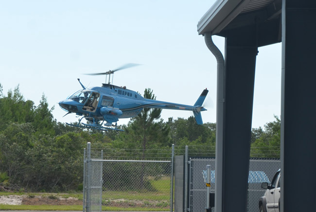 East Flagler Mosquito Control's12-year-old helicopter coming in for a landing at the district's new facility at the south end of the Flagler County Executive Airport. (© FlaglerLive)