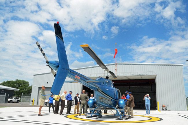 Mosquito Control Pilot Kevin Card this morning gave visitors a brief overview of his duties at the end of a tour of the East Mosquito Control District's new facilities at the Flagler County Executive Airport. (© FlaglerLive)