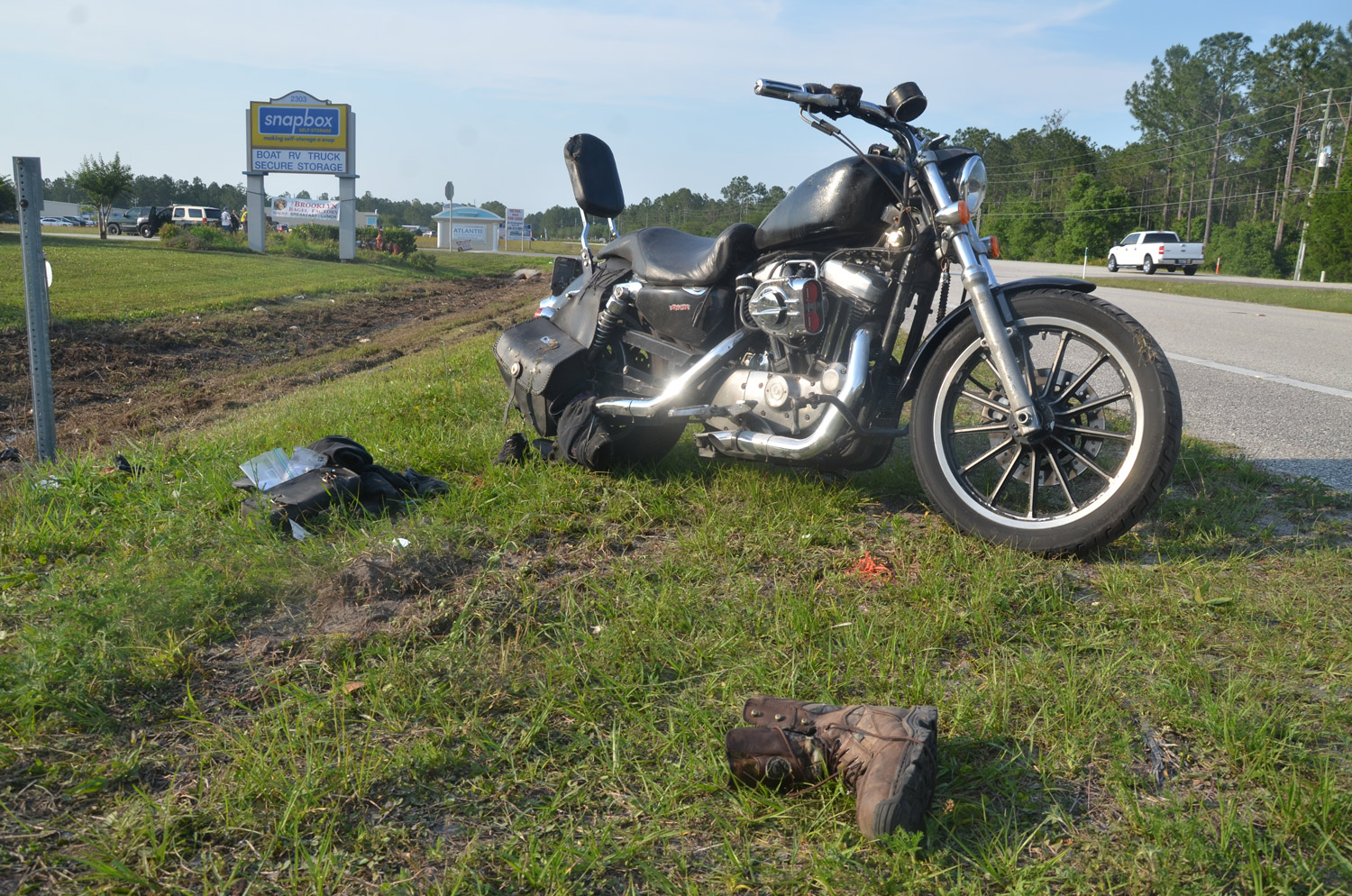The victims' motorcycle after it was righted by the side of U.S. 1 this afternoon, with some of the victims' belongings still at the scene. Click on the image for larger view. (© FlaglerLive)