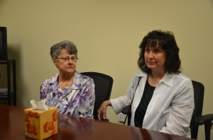 Dana Mulhall's mother Angela Mulhall, left, and Dana's sister Karen Mulhall Theriault, who made generous use of the kleenex box as they reflected on the week-long trial after it concluded today, and remembered Dana. Click on the image for larger view. (© FlaglerLive)