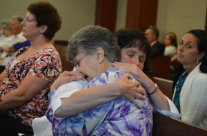 Angela Mulhall, in the foreground, Dana's 76-year-old mother, in a hug with his sister, Karen Mulhall Theriault, immediately after the verdict was announced. Click on the image for larger view. (© FlaglerLive)