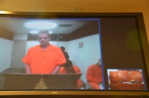 Christopher Munson during his video-link appearance before Judge Dennis Craig Wednesday morning. Click on the image for larger view. (© FlaglerLive)