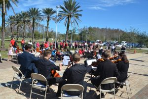 Performances by the student-musicians of the Flagler Youth Orchestra accompany the ceremony. (© FlaglerLive)