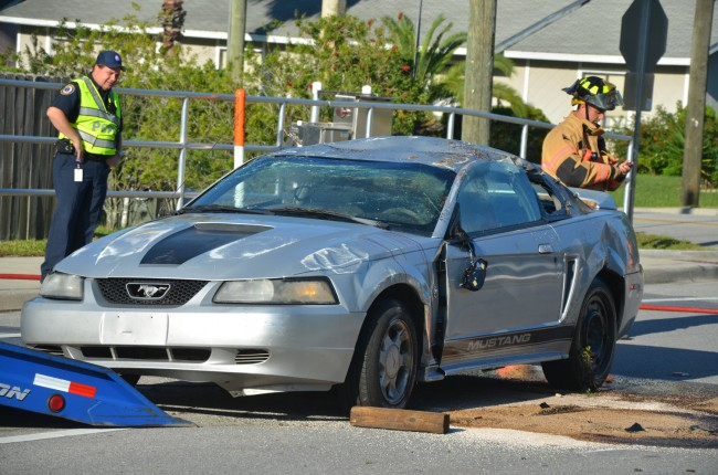 The Mustang after Roger's Towing righted it. Click on the image for larger view. (© FlaglerLive)