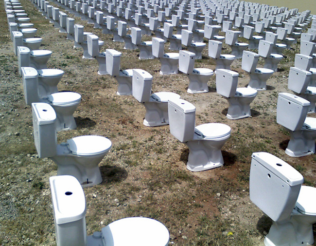 Detail from a 2008 installation by artist Nada Sehnaoui in Beirut. toilets and toilet seats. Drug testing. (Blogging Beirut)