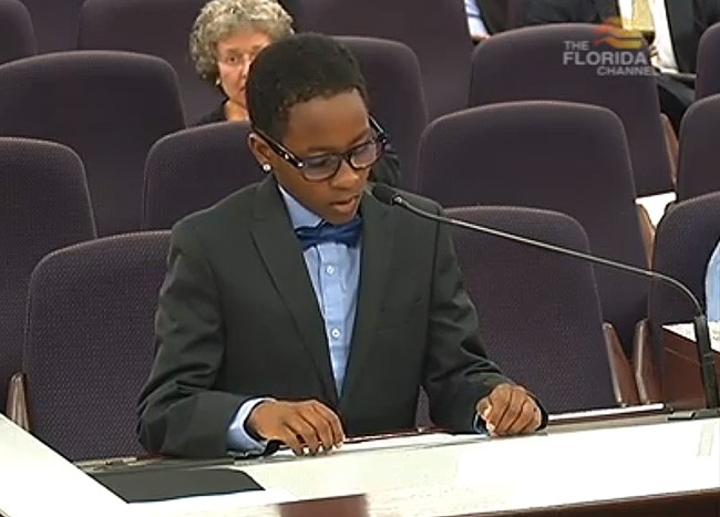 10-year-old Nathan Gill addressing the Senate Rules Committee about his two dads on Monday just before he was cut off by Committee Vice Chair Darren Soto, the Kissimmee Democrat. (Florida Channel)