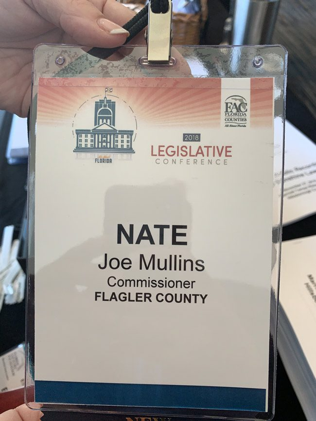 Newly-elected  Flagler County Commissioner Joe Mullins is attending the Florida Association of Counties' Legislative Conference in Tampa this week. But he had a surprise when he went to pick up his name badge: organizers had his name in second billing, below 'Nate,' former Commissioner Nate McLaughlin, whom Mullins defeated. 'I just can't win,' Mullins joked in a text. 'You think someone is trying to set me off.' He added: 'Things like this don;t bother me, they make for funny stories.' On Tuesday, he'd been attending a seminar on ethics, public records and Sunshine laws.