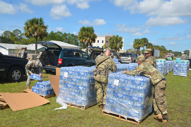 The National Guard distributed food and water this week at the county airport. Next Monday, Farm Share will be at the airport to provide meals and other goods to residents. (© FlaglerLive)